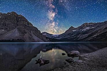 The galactic centre region of the Milky Way in Sagittarius setting behind Bow Glacier at the end of Bow Lake, in Banff National Park, Alberta.
