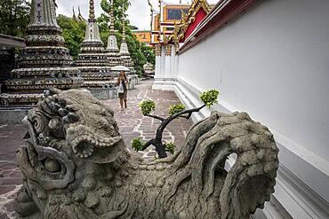 sculpture and Chedis inside Wat Pho temple, Bangkok, Thailand
