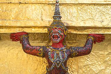 Statue of demon on a Golden Chedi,  at the temple of the Emerald Buddha Wat Phra Kaeo, Grand Palace, Bangkok, Thailand