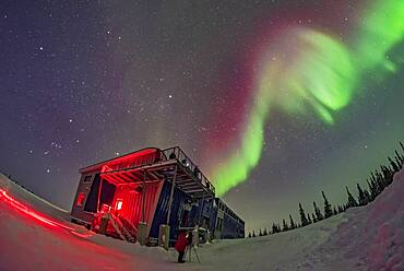 Orion and the winter sky, at left, and a swirl of colourful aurora over the Churchill Northern Studies Centre, in a display on February 11, 2018. People from the first Learning Vacations group of the season are shooting the Lights.