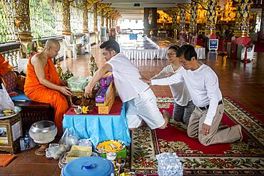 Donation to monks, Wat Suan Dok temple, Chiang Mai, Thailand