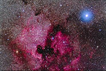 The North America Nebula (NGC 7000) and associated nebulosity and star clusters, near the bright blue-white star Deneb in Cygnus.