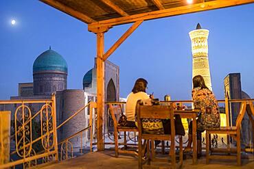 Minor Cafe House. At right Kalon minaret and mosque. At left Mir-i-Arab medressa , Bukhara, Uzbekistan