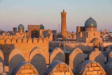 Skyline, Kalon minaret and mosque. And Mir-i-Arab medressa, from Ark, Bukhara, Uzbekistan