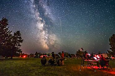A Perseid meteor streaks down the Milky Way over the Saskatchewan Summer Star Party in the Cypress Hills of southwest Saskatchewan, at Cypress Hills Interprovincial Park, a Dark Sky Preserve. The Milky Way shines to the south. About 350 stargazers attend the SSSP every year.
