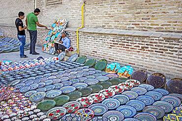 Craftsman selling traditional uzbek pottery, Bukhara, Uzbekistan