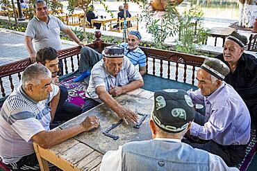 Men playing domino, chaijana, traditional tea house, in Lyabi-Hauz square, Bukhara, Uzbekistan