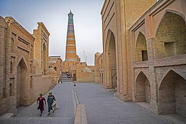 Islom Hoja Minaret. At right Sherghozi Khan Medressa. At left  Pahlavon Mahmud Mausoleum, Khiva, Uzbekistan