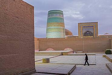 Kalta Minor minaret, street scene in Ichon-Qala, old city, Khiva, Uzbekistan