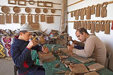 Artisans carving the wood, Khiva, Uzbekistan