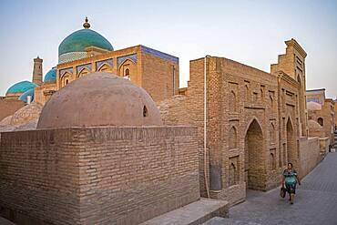 Pahlavon Mahmud Mausoleum. Street scene in Ichon-Qala or old city, Khiva, Uzbekistan