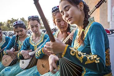 women playing dutar, folk show,in Rukhobod Mausoleum, Samarkand, Uzbekistan