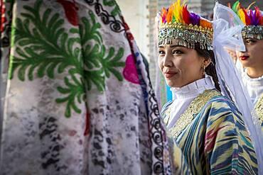 women in traditional dress, for folk dance, dancer, in Rukhobod Mausoleum, Samarkand, Uzbekistan