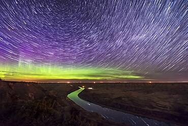 Circumpolar star trails and aurora over the Red Deer River, Alberta from the Orkney Viewpoint north of Drumheller on May 5, 2018.