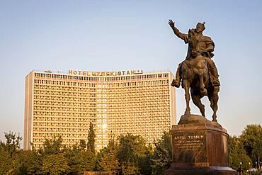 Amir Timur statue, in Amir Timur square, and Hotel Uzbekistan, Tashkent, Uzbekistan