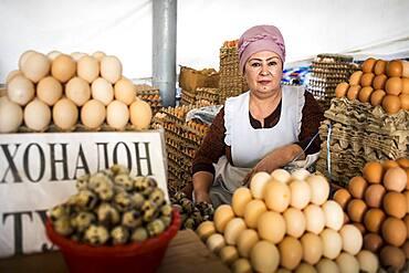 Woman selling eggs. At Chorsu Bazaar,Tashkent, Uzbekistan