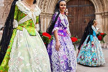 Flower offering parade,People with Floral tributes to `Virgen de los desamparados��, Fallas festival, Plav�a de l��Almoina square,Valencia