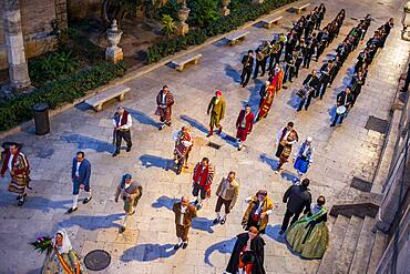 Flower offering parade,People with Floral tributes to `Virgen de los desamparados��, Fallas festival,carrer del Micalet street,Valencia