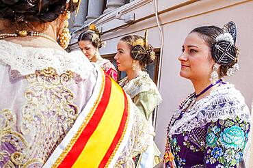 Women in Fallera Costumes,in the roof of town hall, Fallas festival,Valencia