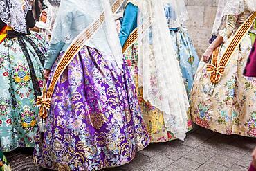 Detail, women in Fallera Costumes during Flower offering parade, tributes to `Virgen de los desamparados��, Fallas festival, Plaza de la Virgen square,Valencia