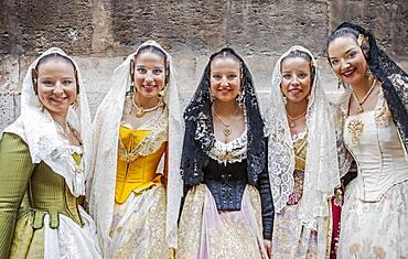 Women in Fallera Costumes during Flower offering parade, tribute to `Virgen de los desamparados��, Fallas festival, Plaza de la Virgen square,Valencia