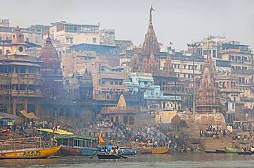 Manikarnika Ghat, the burning ghat, on the banks of Ganges river, Varanasi, Uttar Pradesh, India.