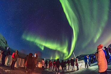 Aurora tourists taking in the sky show on March 14, 2018 from the aft deck of the Hurtigruten ship the m/s Nordnorge on the journey south, from a location north of Tromsø this night.