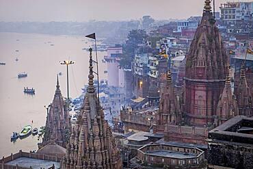 In first position the rooftop of Manikarnika ghat, general view of ghats rooftops, in Ganges river, Varanasi, Uttar Pradesh, India.