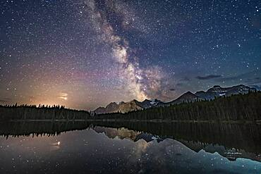 Mars (at left in clouds) and the summer Milky Way over Lake Herbert and reflected in the still waters this night. This is in Banff National Park, Alberta. I shot this July 17, 2018 on a night that gradually clouded up, after a run of two very good nights previous to this.