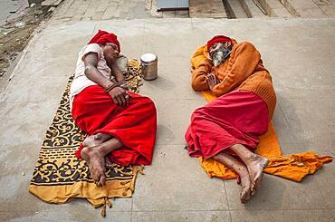 Sadhus sleeping, in the ghats of Ganges river, Varanasi, Uttar Pradesh, India.
