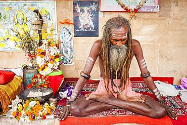 Sadhu meditating, in the ghats of Ganges river, Varanasi, Uttar Pradesh, India.