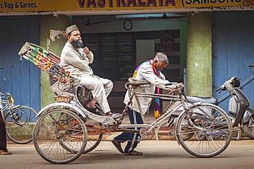 Rickshaw, in Godowlia Road, downtown, Varanasi, Uttar Pradesh, India.