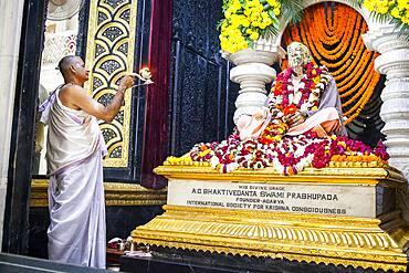Praying, statue of A. C. Bhakivedanta Swami Prabhupada the founder of hare Krishna movement, in  ISKCON temple, Sri Krishna Balaram Mandir,Vrindavan,Mathura, Uttar Pradesh, India