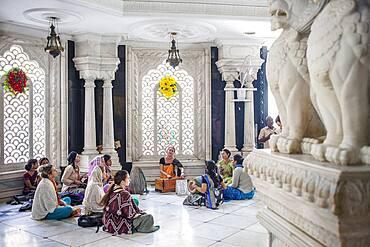 Group of women praying, in ISKCON temple, Sri Krishna Balaram Mandir,Vrindavan,Mathura, Uttar Pradesh, India