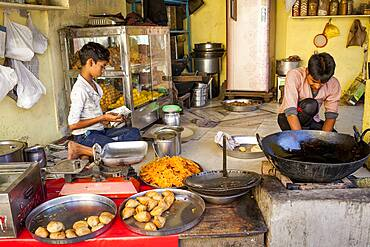 Children working, in Traditional indian restaurant (dhaba), Gotam Nagar street (main street),Historical Center,Vrindavan, Mathura, Uttar Pradesh, India