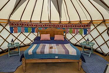 Interior of Yurt, in Yurt village near Hay on Wye to provide glamping accommodation for visitors to Hay Festival, Hay on Wye, Wales