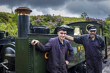 Firemen, Vale of Rheidol Steam Railway, at Devil's Bridge Station, near Abertsywyth, Ceredigion, Wales