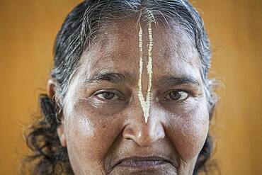 Portrait of Widow, in Ma Dham ashram for Widows of the NGO Guild for Service, Vrindavan, Mathura district, India
