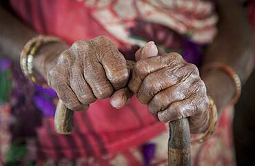 hands of Mrs Kambeti (widow), in Ma Dham ashram for Widows of the NGO Guild for Service, the NGO proposes at widows to wear colorful clothes,  Vrindavan, Mathura district, India