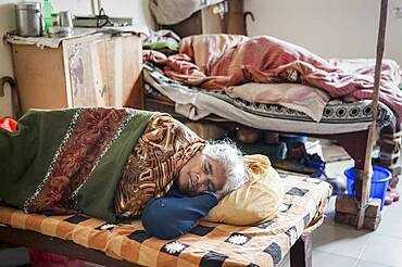 Widows sleeping, in Ma Dham ashram for Widows of the NGO Guild for Service, Vrindavan, Mathura district, India