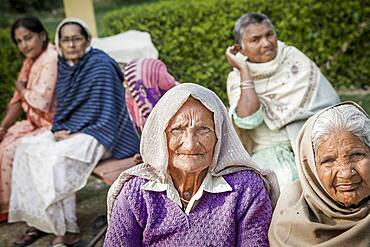 Group of Widows, in Ma Dham ashram for Widows of the NGO Guild for Service, Vrindavan, Mathura district, India