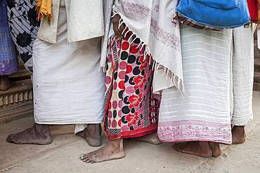 Widows on line for collecting their daily food ration offered by an ashram in compensation for their prayers , Vrindavan, Mathura district, India