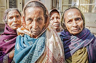 Group of widows begging, Vrindavan, Mathura district, India