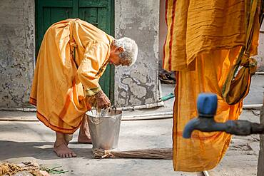 Window washing clothes on the street, facing the room where resides,  Vrindavan, Mathura district, India