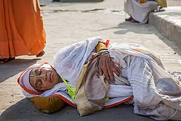Widow sleeping in the street,homless, Vrindavan, Mathura district, India