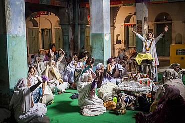 Widows praying in a Bhajan ashram, Vrindavan, Mathura district, India