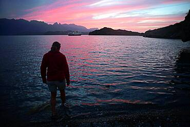 Woman in beach water at sunset, Sea of Cortez, Baja California, Mexico