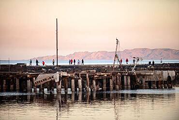People walking on Santa Rosalia port dock, Baja California Sur, Mexico