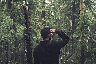 Young man in the woods, Yukon Territory, Canada