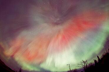 April 17/18, 2001 aurora, taken from home in Alberta. looking south. Part of a series taken looking same direction as substorm hit and subsided, from Image #2 to #15, on Roll #1. (Roll #2 was second camera shooting Provia 100F with 28mm lens and 18mm lens.) All images in this series (#1-02 thru 15) processed in Photoshop with nearly identical enhancements to contrast and colour. Brightness toned down for longer overexposed shots (early ones).